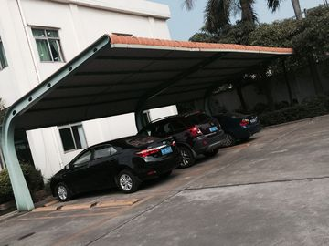 China 4 sets Small Cars Parking Shed Garage Steel Frame With Red Arc Shape Roof Top supplier