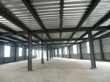 China High Strength Garage Steel Frame With Colored Steel Sheet And Frp Lighting Tiles distributor